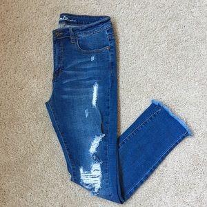 Machine stretchy Medium wash denim jeans size 7